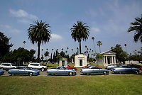 Los Angeles--Hollywood Forever Cemetary--GM's EV 1 Electric Car line up inside the cemetary as owners participate in mock car funeral as the program for electric vehicles is scrapped by the end of summer.