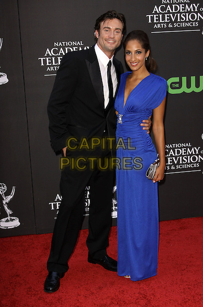 DANIEL GODDARD & CHRISTEL KHALIL.36th Annual Daytime Emmy Awards held At The Orpheum Theatre, Los Angeles, California, USA..August 30th, 2009.emmys full length black suit hand in pocket blue dress long maxi .CAP/ADM/KB.©Kevan Brooks/AdMedia/Capital Pictures.