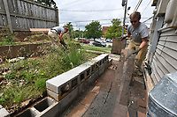 NWA Democrat-Gazette/J.T. WAMPLER AmeriCorps National Civilian Community Corps (NCCC) members C.J. Hemphill (RIGHT) of Roland and Tia Ruh of Lakeville MN clean up Thursday June 6, 2019 at the former Hi-Way Inn and Motel on North College Ave. <br />
