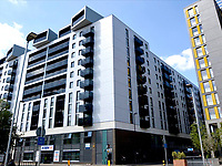 BNPS.co.uk (01202 558833)<br /> Pic:  AaronHaile/BNPS<br /> <br /> The couple have moved from this block of flats in London.<br /> <br /> Not so scilly ...<br /> <br /> A couple who have swapped bustling London for the idyllic Isles of Scilly say they are loving their new life.<br /> <br /> Aaron Haile, 39, and her husband Mark Bothwick, 45, made the bold decision to quit the capital for the tiny island of Bryher off the Cornish coast.<br /> <br /> They have taken on the island's only general store which doubles as a post office for the outpost's 84 inhabitants - in stark contrast to London's 8.7million population.<br /> <br /> Their previous home was a two bedroom Lewisham flat in a tower block in south east London.