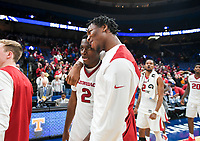 NWA Democrat-Gazette/CHARLIE KAIJO Arkansas Razorbacks forward Gabe Osabuohien (22) hugs forward Adrio Bailey (2) during the Southeastern Conference Men's Basketball Tournament, Thursday, March 8, 2018 at Scottrade Center in St. Louis, Mo.