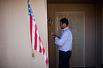 Republican congressional candidate Ricky Gill writes a note at a home while canvassing in Stockton, Calif., September 18, 2012.