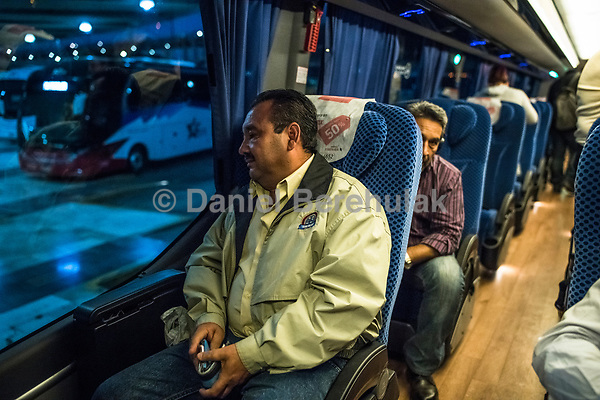 Vicky an Carlos travel home by bus back home to Xalapa after a meeting on the 28th of October, 2017 in Mexico City, Mexico. <br /> Photo Daniel Berehulak for the New York Times