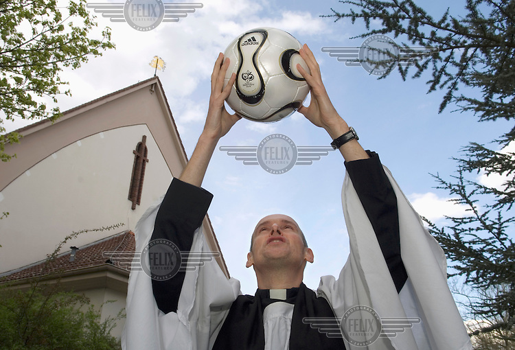 The Reverend Pastor Christopher Jage-Bowler of St. George's Anglican Church. With Germany's Ecumenical Council, he organised a friendly football match between a team of imams and a team of priests to bring the local Christian and Islamic communities together. The linesmen were Jewish.