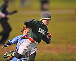 The Panthers vs. The Eagles' Philip Neilson in Oxford Park Commission flag football, at FNC Park in Oxford, Miss. on Tuesday, November 19, 2013.