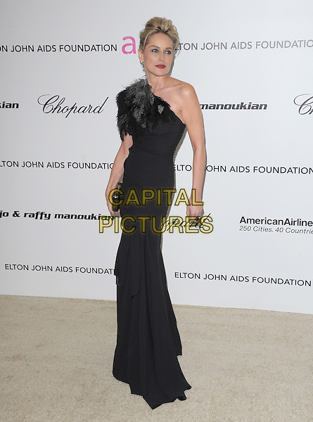 SHARON STONE .The 19th Annual Elton John AIDS Foundation Academy Awards Viewing Party held at The Pacific Design Center Outdoor Plaza in West Hollywood, California, USA..February 27th, 2011 .full length grey gray black feathers one shoulder dress maxi clutch bag.CAP/RKE/DVS.©DVS/RockinExposures/Capital Pictures.