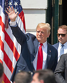 United States President Donald J. Trump waves to a member of the crowd after hosting Martin Truex Jr., the NASCAR Cup Series champion, and his team, on the South Lawn of the White House in Washington, DC on Monday, May 21, 2018.  Truex competes full-time in the Monster Energy NASCAR Cup Series for Furniture Row Racing.<br /> Credit: Ron Sachs / CNP
