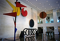 "Chicago: Sears Tower--Alexander Calder Mobile, 1974. ""Universe"", a ""moving mural"". Elements are Spine, three flowers, Helix pendulum, and the sun. Photo '88."
