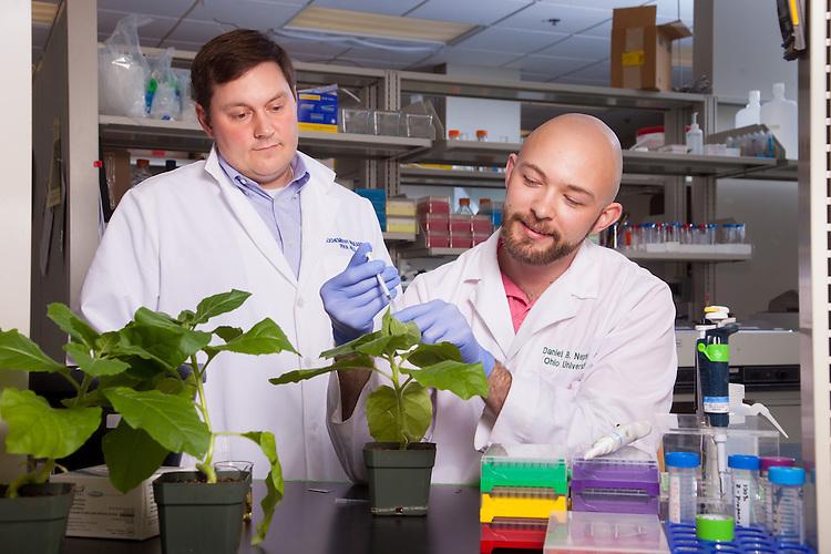 Assistant Professor Michael Held, left, with student Daniel B. Nething, Biochemistry Research Facility Ohio University. © Ohio University / Photo by Jonathan Adams