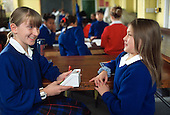 Two girls time each other holding breath during a Year 7 Science class at Maria Fidelis RC School, Camden.