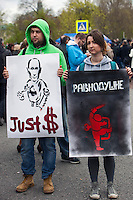Moscow, Russia, 06/05/2013..Protesters hold placards in Bolotnaya Square as some 20,000 demonstrators protested against Russian President Vladimir Putin and demanded the release of political prisoners. The demonstration marked the first anniversary of a protest that descended into violence between protestors and police and resulted in over 600 arrests.