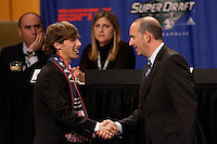 MLS Commissioner Don Garber shakes hands with the fifth pick of the draft, Wells Thompson who was picked by the New England Revolution during the first round of the MLS SuperDraft at the Indiana Convention Center, Indianapolis, IA, on Jan 12, 2007.
