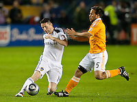 CARSON, CA - November 20, 2011: LA Galaxy forward Robbie Keane  (14) and Houston Dynamo midfielder Danny Cruz (5) during the MLS Cup match between LA Galaxy and Houston Dynamo at the Home Depot Center in Carson, California. Final score LA Galaxy 1, Houston Dynamo 0.