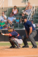 Home plate umpire Bryan Dormaier gets into position behind Will Vazquez (10) of the Greenville Drive at Fieldcrest Cannon Stadium in Kannapolis, NC, Sunday August 10, 2008. (Photo by Brian Westerholt / Four Seam Images)