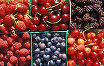 Strawberries, cherries, blackberries, raspberries and blueberries in baskets at produce stand; Willamette Valley, Oregon.