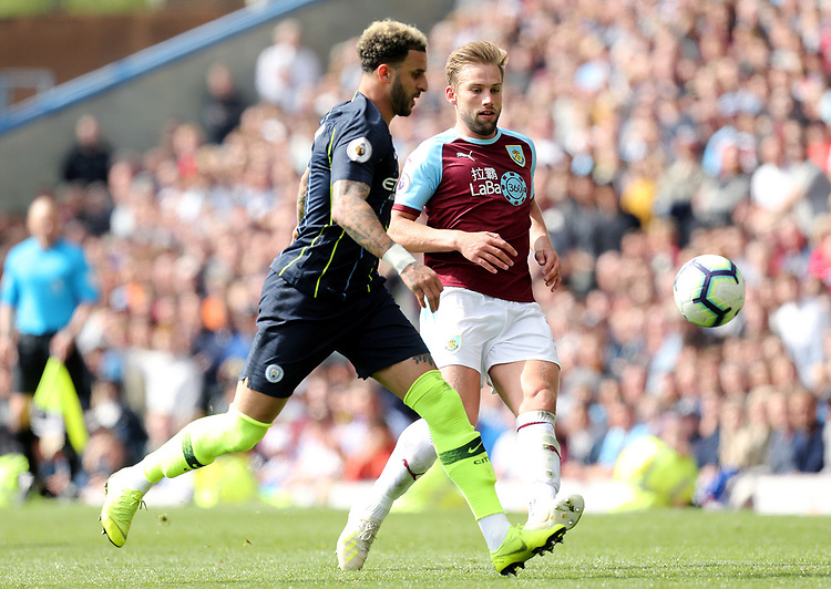 Burnley's Charlie Taylor vies for possession with Manchester City's Kyle Walker<br /> <br /> Photographer Rich Linley/CameraSport<br /> <br /> The Premier League - Burnley v Manchester City - Sunday 28th April 2019 - Turf Moor - Burnley<br /> <br /> World Copyright © 2019 CameraSport. All rights reserved. 43 Linden Ave. Countesthorpe. Leicester. England. LE8 5PG - Tel: +44 (0) 116 277 4147 - admin@camerasport.com - www.camerasport.com