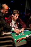 Tournament Director Mike Ward helps count out Jake Toole' all in bet.