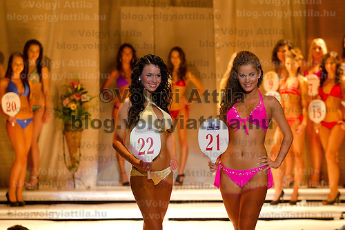 Viktoria Gili (left) and Edina Gosztola (right) attends the Miss Hungary 2010 beauty contest held in Budapest, Hungary on November 29, 2010. ATTILA VOLGYI