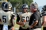 Palos Verdes, CA 10/25/13 - Michael Christensen (Peninsula Head Coach), Carlo Merola (Peninsula #60) and Tobi Ibraheem (Peninsula #5) in action during the Mira Costa vs Peninsula varsity football game at Palos Verdes Peninsula High School.
