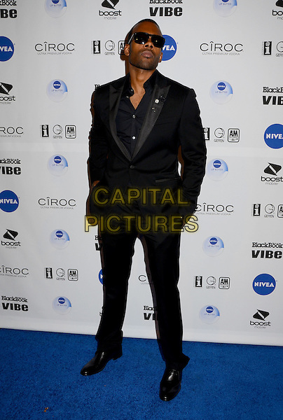 Mario Barrett.Interscope Records 2012 American Music Awards Dinner and After Party held at The Redbury Hotel, Hollywood, California, USA. .November 18th, 2012.full length black suit sunglasses shades hands in pockets .CAP/ADM/BT.©Birdie Thompson/AdMedia/Capital Pictures.