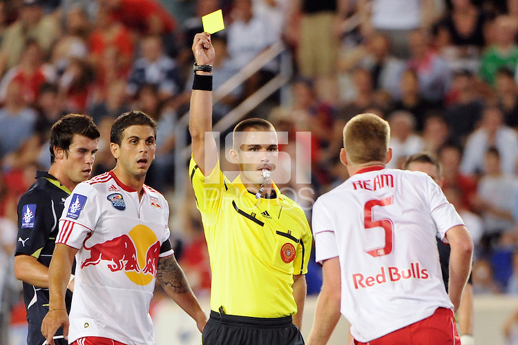 Referee Chris Penso issues a yellow card to Tim Ream (5) of the New York Red Bulls. Tottenham Hotspur F. C. defeated the New York Red Bulls 2-1 during a Barclays New York Challenge match at Red Bull Arena in Harrison, NJ, on July 22, 2010.