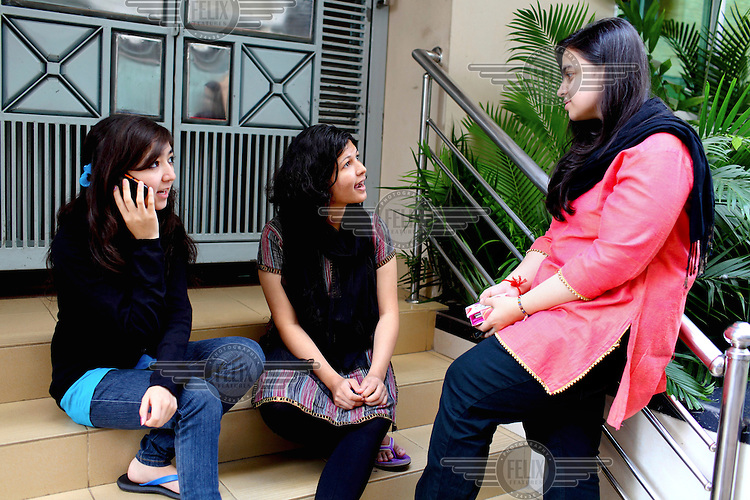Students discuss an assignment outside a classroom at the Asian University for Women. /Felix Features