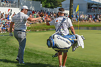 Jon Rahm (ESP) fist bumps his caddie after chipping in from off the green on 16 during 3rd round of the World Golf Championships - Bridgestone Invitational, at the Firestone Country Club, Akron, Ohio. 8/4/2018.<br /> Picture: Golffile | Ken Murray<br /> <br /> <br /> All photo usage must carry mandatory copyright credit (© Golffile | Ken Murray)