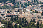 The al-Ghawanima Minaret on the edge of the Temple Mount and Muslim Quarter in the Old City of Jerusalem.  The Old City of Jerusalem and its Walls is a UNESCO World Heritage Site.  In the foreground are the trees of the al-Haram ash-Sharif or Temple Mount.