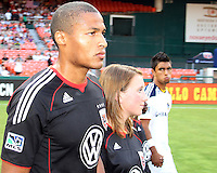 Jordan Graye #16 of D.C. United and A.J. DeLaGarza #20 of the Los Angeles Galaxy enter the field during an MLS match at RFK Stadium on July 18 2010, in Washington D.C. Galaxy won 2-1.