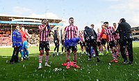 Lincoln City's Bruno Andrade, left, and Lincoln City's Shay McCartan celebrate after securing promotion from Sky Bet League Two<br /> <br /> Photographer Chris Vaughan/CameraSport<br /> <br /> The EFL Sky Bet League Two - Lincoln City v Cheltenham Town - Saturday 13th April 2019 - Sincil Bank - Lincoln<br /> <br /> World Copyright © 2019 CameraSport. All rights reserved. 43 Linden Ave. Countesthorpe. Leicester. England. LE8 5PG - Tel: +44 (0) 116 277 4147 - admin@camerasport.com - www.camerasport.com