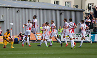 Asa Hall of Cheltenham (obscured) is mobbed after scoring his side's first goal during the Sky Bet League 2 match between Newport County and Cheltenham Town at Rodney Parade, Newport, Wales on 10 September 2016. Photo by Mark  Hawkins / PRiME Media Images.