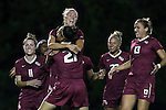 23 October 2014: Florida State's Dagny Brynjarsdottir (ISL) (above) jumps into the arms of Marta Bakowska-Mathews (ENG) (21) while celebrating her goal with Isabella Schmid (GER) (11), Emma Koivisto (FIN) (23), and Kristin Grubka (13). The University of North Carolina Tar Heels hosted the Florida State University Seminoles at Fetzer Field in Chapel Hill, NC in a 2014 NCAA Division I Women's Soccer match. The game ended in a 1-1 tie after double overtime.