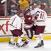 Patch Alber (BC - 3), T.J. Syner (UMass - 14), Pat Mullane (BC - 11) - The Boston College Eagles defeated the University of Massachusetts-Amherst Minutemen 3-2 to take their Hockey East Quarterfinal matchup in two games on Saturday, March 10, 2012, at Kelley Rink in Conte Forum in Chestnut Hill, Massachusetts.
