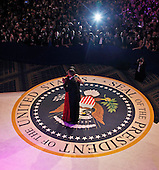 United States President Barack Obama and first lady Michelle Obama dance together at the Commander-in-Chief's Inaugural Ball in Washington, at the Washington Convention Center during the 57th Presidential Inauguration on Monday, January  21, 2013. .Credit: Pablo Martinez Monsivais / Pool via CNP