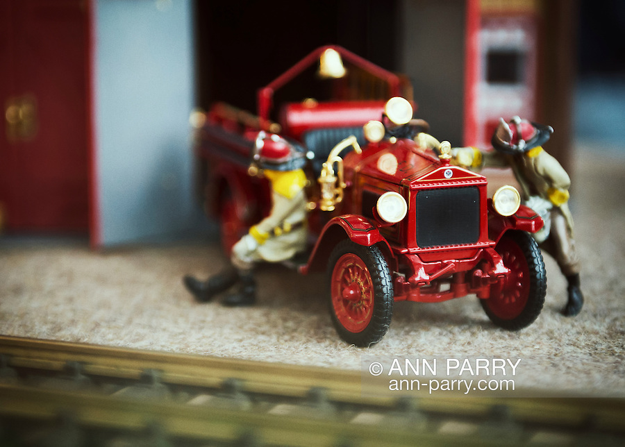 Dec. 26, 2012 - Garden City, New York, U.S. - The Long Island Garden Railway Society large-scale model train display includes a vintage style model fire house  and fire truck at the festive winter holiday attraction in the vast 3-floor atrium of Cradle of Aviation museum. LIGRS shares the knowledge, fun, and camaraderie of large-scale railroading both indoors and in the garden, and is family oriented.