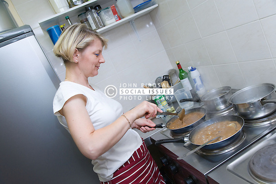 Chef cooking food in kitchen of Polish restaurant,