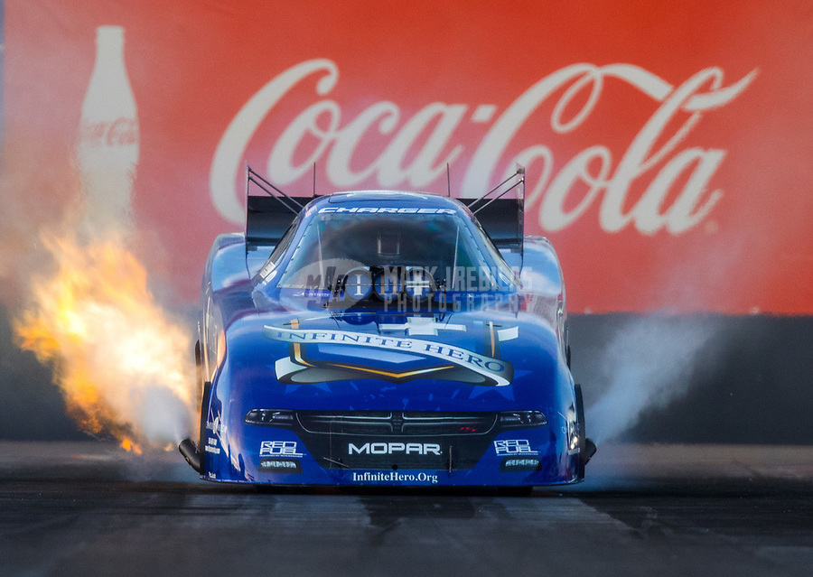 Feb 3, 2017; Chandler, AZ, USA; NHRA funny car driver Jack Beckman does a burnout during Nitro Spring Training preseason testing at Wild Horse Pass Motorsports Park. Mandatory Credit: Mark J. Rebilas-USA TODAY Sports