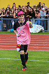 London, UK on Sunday 31st August, 2014. Leondre from Bars & Melody with a gift from a fan during the Soccer Six charity celebrity football tournament at Mile End Stadium, London.