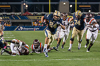 Pitt running back James Conner (24) scores on a 15-yard touchdown run. The Pitt Panthers defeated the Virginia Tech Hokies 21-16 at Heinz Field, Pittsburgh Pennsylvania on October 16, 2014