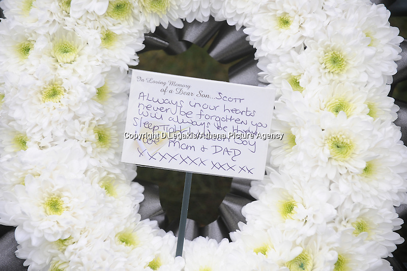 Pictured: Floral tribute from Scott's parents.<br /> Re: Swansea City FC players expressed their condolences in person to the family of devoted football fan Scott Bryant.<br /> Ashley Williams, Nathan Dyer, Wayne Routledge, Ben Davies, Leon Britton, Chico Flores, Angel Rangel, Alejandro Pozuelo and others paid their respects after the funeral service at Swansea Crematorium.<br /> Mourners responded with a round of applause.<br /> Scott, 22, died at his home in St Thomas while watching the Swans play Manchester United at Old Trafford on January 11 2014.