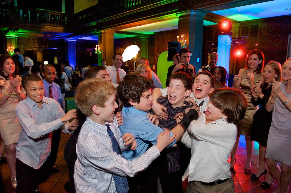 Boys roughhousing at a Bar Mitzvah at The Harvard Club in NY.