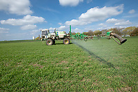 Spraying winter wheat with fungacide - Lincolnshire, April