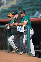 Greensboro Grasshoppers manager Miguel Perez (right) watches the action from the dugout during the game against the Hickory Crawdads at L.P. Frans Stadium on May 26, 2019 in Hickory, North Carolina. The Crawdads defeated the Grasshoppers 10-8. (Brian Westerholt/Four Seam Images)