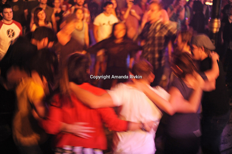 Audience members dance in a circle during a live set by Pet Peeve at the Double Door in Chicago, Illinois on June 5, 2011.