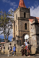 AJ2496, Dominica, Caribbean, Caribbean Islands, cathedral, School children walking home from school in front of cathedral in Portsmouth on the island of Dominica.