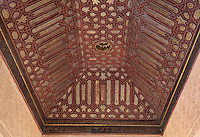 Painted coffered ceiling made under the Catholic kings after the reconquest in Mudejar style in the South side chamber of the Gilded Room or Cuarto Dorado, built under Mohammed V in the 14th century, in the Comares Palace, Alhambra Palace, Granada, Andalusia, Southern Spain. The Alhambra was begun in the 11th century as a castle, and in the 13th and 14th centuries served as the royal palace of the Nasrid sultans. The huge complex contains the Alcazaba, Nasrid palaces, gardens and Generalife. Granada was listed as a UNESCO World Heritage Site in 1984. Picture by Manuel Cohen