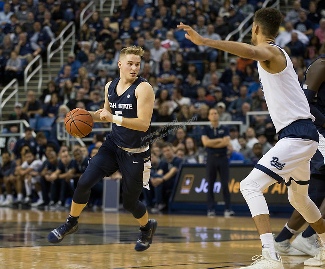 Utah State guard Sam Merrill (5) drives against Nevada        in the second half of an NCAA college basketball game in Reno, Nev.,  Wednesday, Jan. 2, 2019. (AP Photo/Tom R. Smedes)