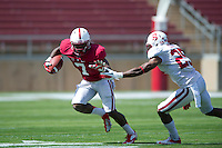 STANFORD, CA- April 13, 2013- The Stanford Cardinal and Whites Spring Game. Ty Montgomery runs the ball from Alex Carter during the Cardinal and White spring game. <br /> <br /> isiphotos.com