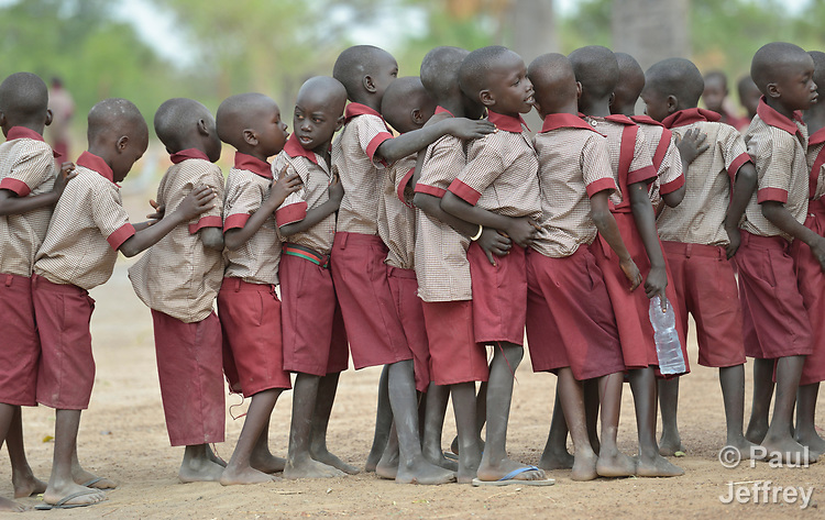 Students jostle each other as they line up during an assembly at the beginning of the day in the Loreto Primary School in Rumbek, South Sudan. The Loreto Sisters began a secondary school for girls in 2008, with students from throughout the country, but soon after added a primary in response to local community demands.
