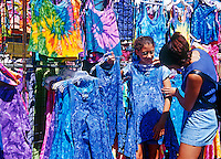 Mother and daughter shopping at a flea market.